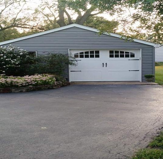 Garage door st louis for Cost to build a garage st louis