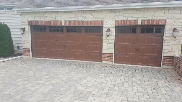 garage doors installed by stone exterior